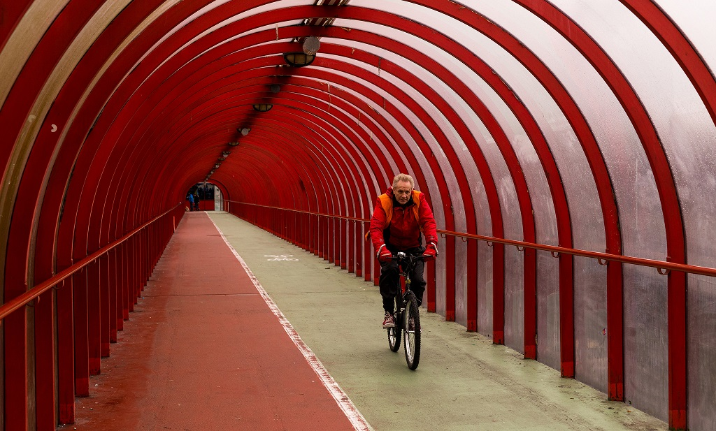 Inside a pedestrian bridge / tunnel in central Glasgow, close to the Scottish Exhibition and Conference Centre.   Fortunately a gentlemen on his bike passed by - dressed very compatibly. I swear I did not change anything with the colour!