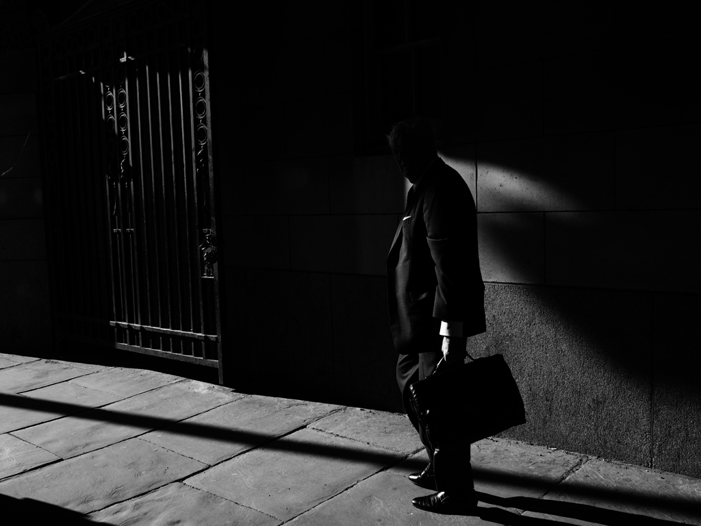 Shot on Pall Mall, London, I particularly like the way the subject's face is shrouded in shadow, again adding a touch of mystery. Who is this gentlemen, where is he going and what is inside his briefcase?