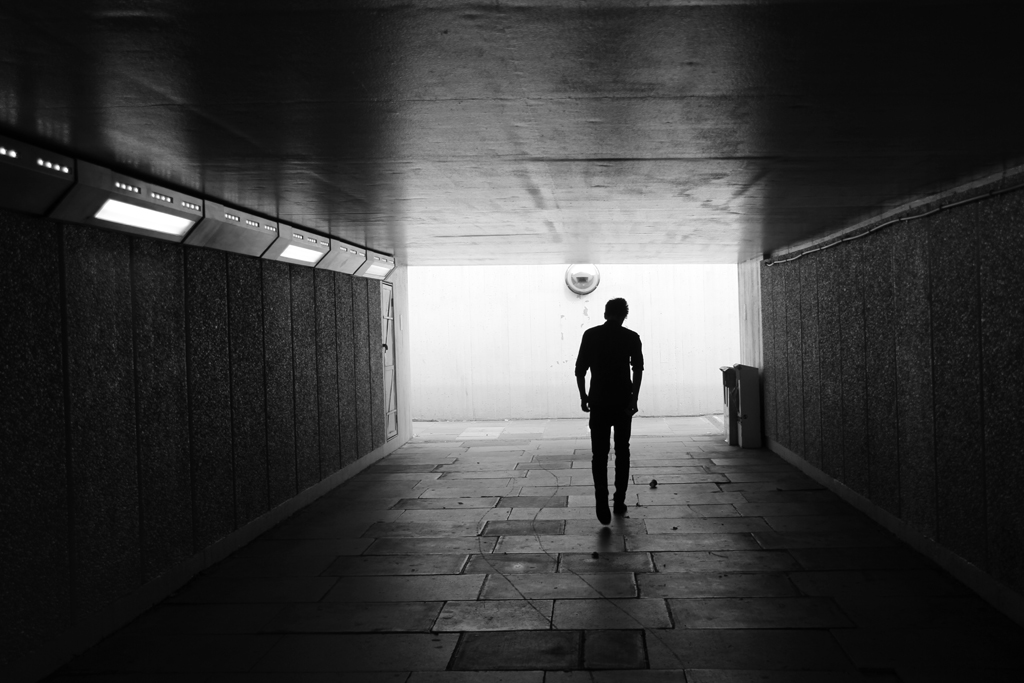 I had to move very quickly to capture this shot, taken in another underpass in Waterloo, London. I had turned the corner, saw this guy walking through into the light and took a few, quick, successive photographs. The light was great and provided a moody silhouette, enhanced by the tilting of the subject's head making us question his thoughts.