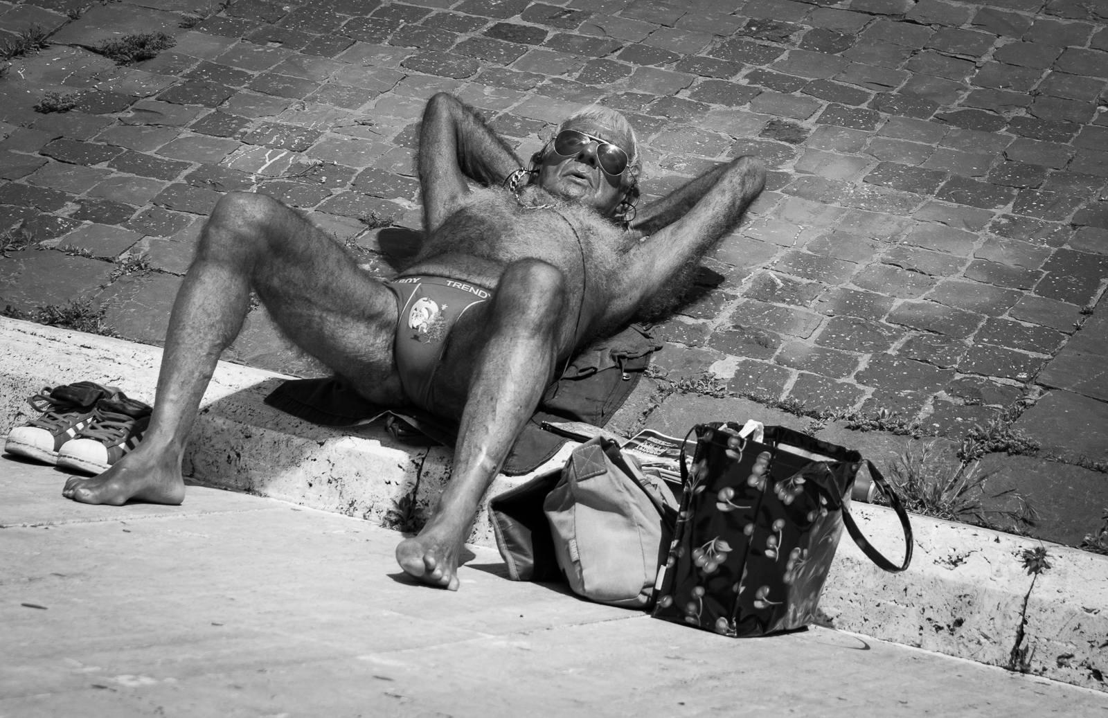 I saw this man on the shores of the lake Tiber. He was very relaxed and enjoyed the sun. Always when the weather is fine, he comes to this place to lie in the sun.