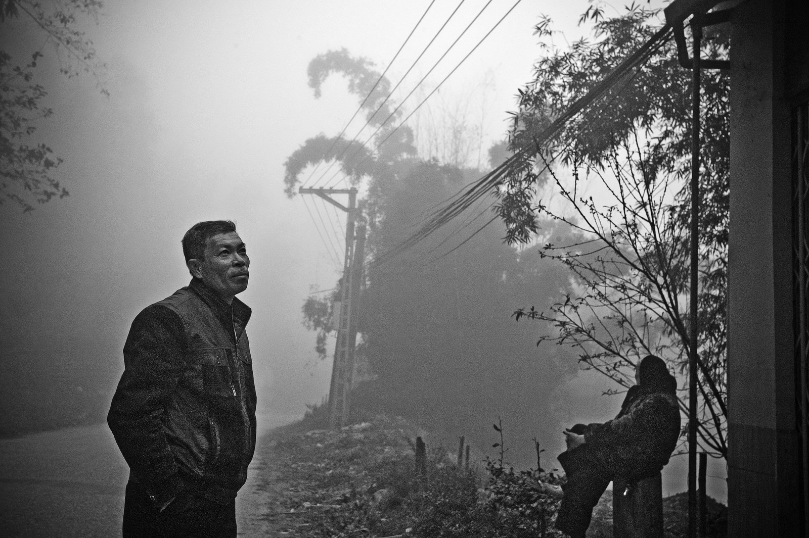 An early evening fog shrouds the outskirts of Sa Pa, northern Vietnam.